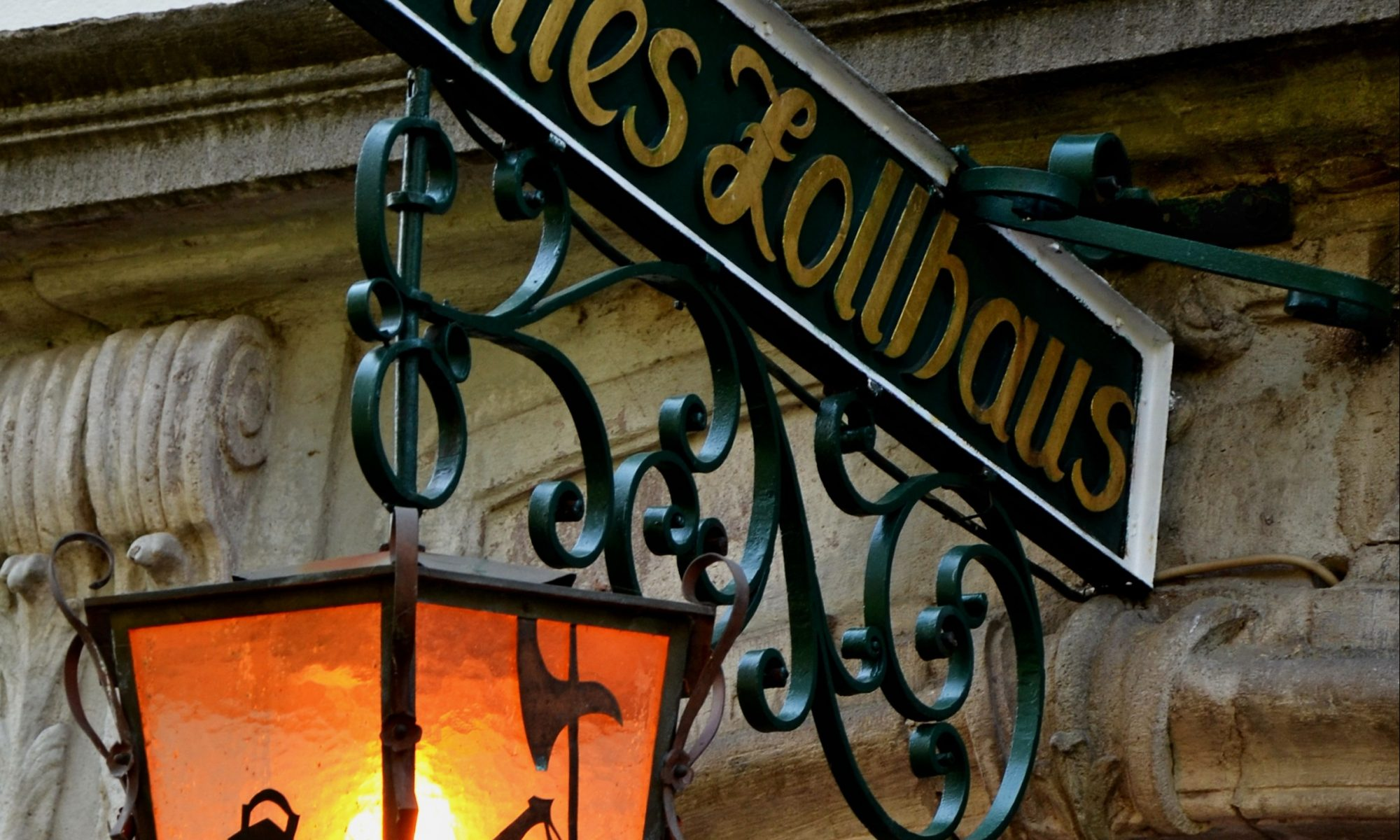 Historic street lamp and sign.