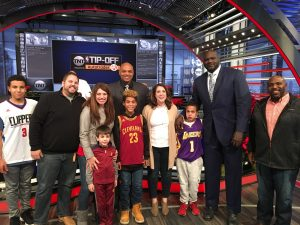 Melissa Hogan, fourth from right, and her family on Inside the NBA, talking about Hunter Syndrome and Project Alive.